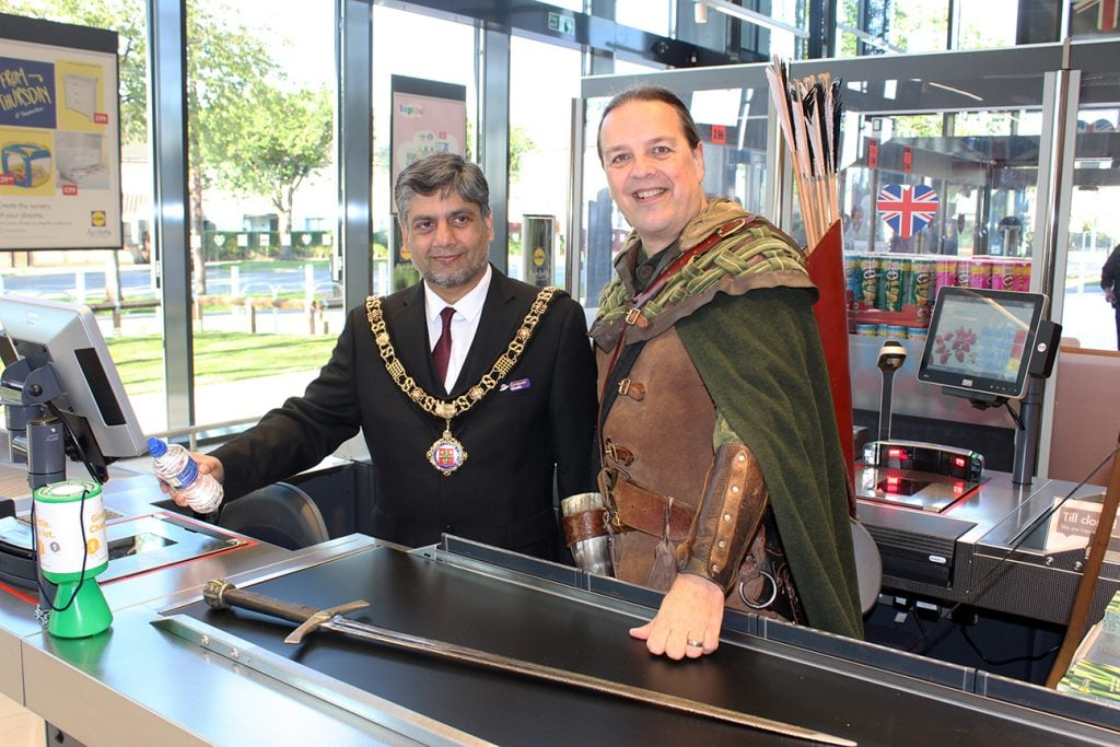 Lord Mayor, Cllr Liaqat Ali and Robin Hood at the checkout in Clifton's new Lidl store
