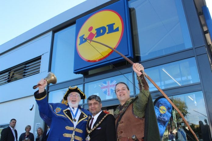 Town crier Peter Taunton (left), Lord Mayor Cllr Liaqat Ali (centre) and Robin Hood (right) outside the new Lidl store in Clifton