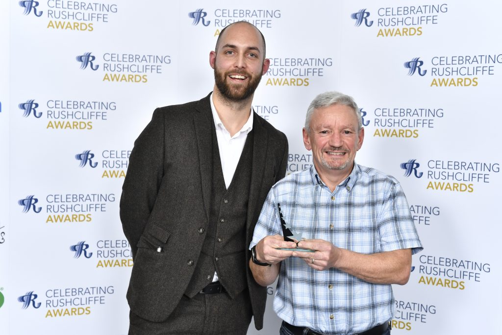 Stephen Rogers from Specsavers West Bridford with Volunteer of the Year Neil Coles from Rushcliffe Squash Club