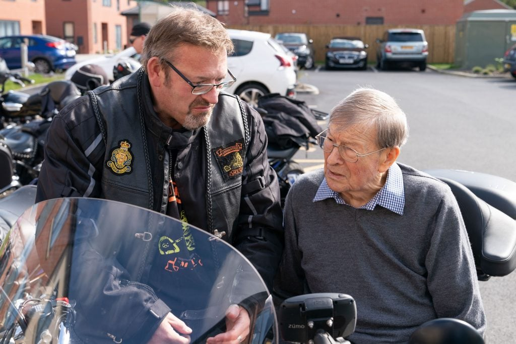Ruddington Manor resident John Pownell with one of the bikers during their visit to the care home SMALL