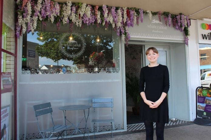 Waitress Jo Lea next to the new floral frontage at White Rabbit Teahouse in West Bridgford