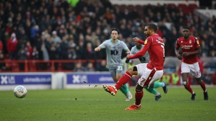 lewis grabban doubles forests lead from the penalty spot.