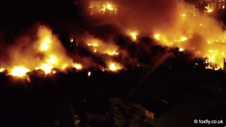 Night footage from drone: Firefighters remain at the scene of airfield blaze