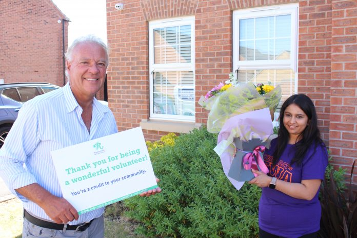 Cllr Robinson presented Hetvi Parekh with a bouquet of flowers for being a great volunteer during COVID 19