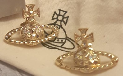 Photograph of gold coloured Vivienne Westwood earrings