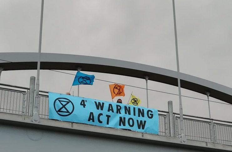 Pictures: Extinction Rebellion activitists hang banners over Nottingham bridges