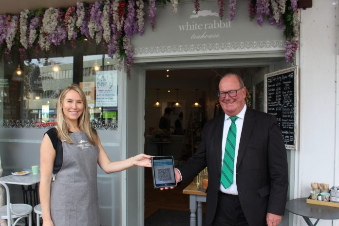 White Rabbit Teahouse West Bridgford co owner Frances Russell and Cllr Andy Edyvean with the new track and trace QR code