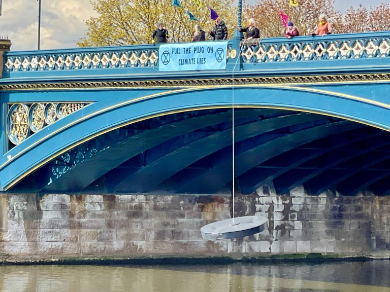 Video: Extinction Rebellion suspend giant bath plug from Trent Bridge